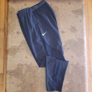 NIKE Black dri-fit joggers with mesh panels